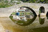the old bridge in Rijeka Crnojevica village also known as Danilo's bridge, Montenegro