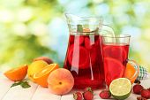 picture of sangria  - sangria in jar and glass with fruits - JPG