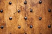 Wood And Metal Door With Metallic Spikes Looking Worn And Grungy.