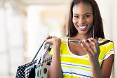 stock photo of mall  - cheerful african american woman shopping in mall - JPG