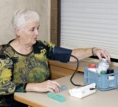Senior Woman Checking Blood Pressure