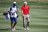 Sep 15, 2013; Lake Forest, IL, USA; Jordan Spieth (r) and caddie Michael Greller walk the eighth fai