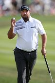 Sep 15, 2013; Lake Forest, IL, USA; Brendon de Jonge waves to the crowd after putting the 18th green