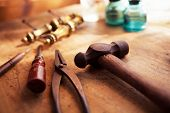 Постер, плакат: Antique restoration Old and well used hammer pliers and screw driver with antique brass drawer han