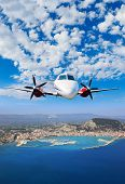 Airplane flying over the island of Zakynthos in Greece Aerial view