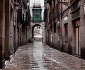 BARCELONA, CATALONIA - June 08: Old streets of Barrio Gotico in June 08, 2013 in Barcelona, Catalonia. It is centre of old city of Barcelona. Center of touristic life