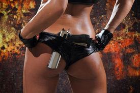 pic of gunshot  - Sexy woman with gun over grunge background - JPG