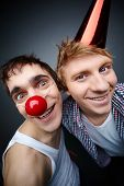 Two guys having fun making faces at camera on fools day