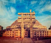 Vintage retro hipster style travel image of Great Stupa - ancient Buddhist monument with overlaid gr