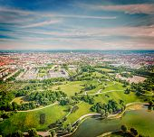 Vintage retro hipster style travel image of aerial view of Olympiapark and Munich from Olympiaturm (