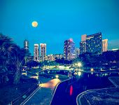 image of kuala lumpur skyline  - Vintage retro hipster style travel image of skyline of Central Business District of Kuala Lumpur in night - JPG