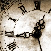 stock photo of wind up clock  - close up of an old looking clock face - JPG