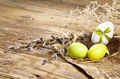 stock photo of quail egg  - Easter basket with Easter Eggs on wooden background - JPG