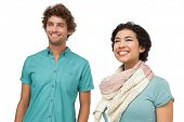 Portrait of a cheerful casual young couple over white background