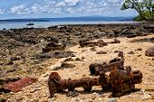 stock photo of million-dollar  - Military hardware and vehicle parts discarded by the US Army at Million Dollar Point Vanuatu after WW2 - JPG