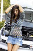 Desperate Female Model In Front Of Broken Car