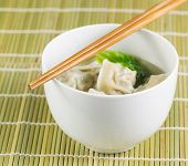 picture of wanton  - Close up photo of freshly made wonton with chopsticks on top of white bowl