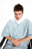 stock photo of neck brace  - Man with a neck brace sitting in a wheelchair in hospital - JPG