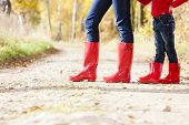 detail of mother and daughter wearing rubber boots