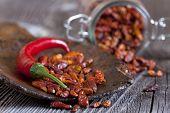 Macro Shot Of Fresh And Dried Chillies