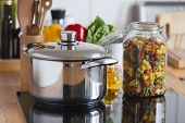 Cooking Pot And A Storage Jar With Colorful Pasta