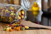 Close Up Of An Open Storage Jar With Colorful Pasta