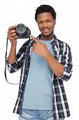 Portrait of a happy man pointing at his camera over white background