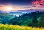Fantastic morning mountain landscape. Overcast colorful sky. Carpathian, Ukraine, Europe. Beauty world.