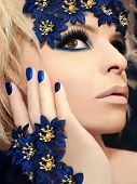 Luxurious blue makeup and manicures.