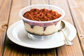 dessert tiramisu in cup on kitchen table