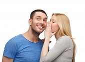 relationships, love and couple concept - smiling girlfriend telling boyfriend secret