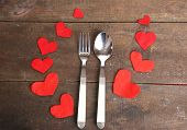Valentines day dinner with table setting on wooden table close-up