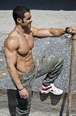 Muscular Construction Worker Shirtless Outdoors In Building Site