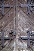 Imposing old weathered doors with black hardware