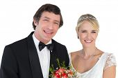 Portrait of newly wed couple smiling over white background