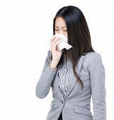 Asian businesswoman sneeze