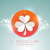 Happy St. Patrick's Day celebration concept with beautiful tag, label or sticker decorated by white shamrock leaf on shiny blue background.