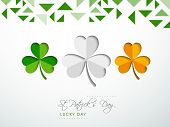 Creative background for Happy St. Patrick's Day celebrations with beautiful Irish lucky shamrock leaves in green, white and orange colour.