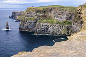 stock photo of cliffs moher  - Famous cliffs of Moher with tower - JPG