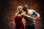 stock photo of samba  - Young couple dances Caribbean Salsa - JPG