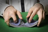 foto of poker hand  - Closeup of hands shuffling cards in casino - JPG