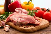 stock photo of veal meat  - Sliced pieces of raw Meat for barbecue with fresh Vegetables and Mushrooms on wooden surface - JPG