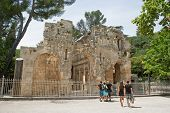 Unidetified Tourists Are Looking At Roman Ruins In Nimes, France