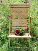 wood chair with bouquet of sunflower