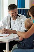 Smiling Pediatrician During Work