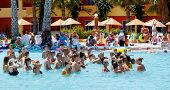 Tourists On Holiday Are Doing Water Aerobics In Pool