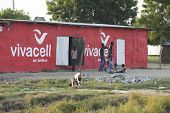 BOR, SOUTH SUDAN-OCTOBER 31 2013: Unidentified teens and children mill about a store operating out o
