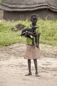 PANWEL, SOUTH SUDAN-NOVEMBER 2 2013: Unidentified child holds a baby goat in the village of Panwell
