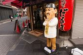 OSAKA, JAPAN - APRIL 18th  :Interestingly human form statue in front of the restaurant, Osaka, Japan on 18th April 2014.