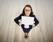 Top view of upset businesswoman holding white blank banner. Place for text